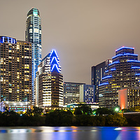 Austin Texas skyine at night photo along with Colorado River with Ashton building, Austonian building, 100 Congress building, and One Congress Plaza building.