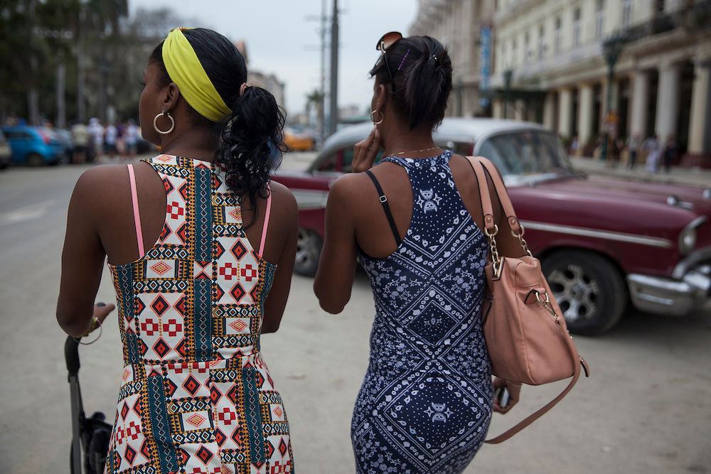 Two young women walk at Parque Central in Havana, Cuba.