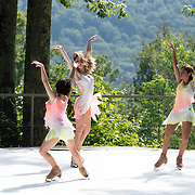 Liz Schmidt, Sinead Kerr, and Dr. Nadine Ahmed Kerr of Ice Dance International perform on the outdoor stage at Jacobs Pillow, July 2019