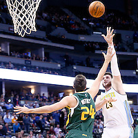 20 November 2016: Denver Nuggets center Jusuf Nurkic (23) goes for the baby hook over Utah Jazz center Jeff Withey (24) during the Denver Nuggets 105-91 victory over the Utah Jazz, at the Pepsi Center, Denver, Colorado, USA.