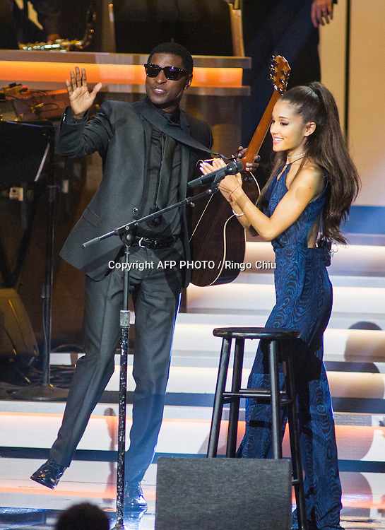 "Kenneth ""Babyface"" Edmonds, left, and Ariana Grande perform at a concert, Stevie Wonder: Songs In The Key Of Life - An All-Star GRAMMY Salute, at Nokia Theatre L.A. Live on February 10, 2015 in Los Angeles, California. AFP PHOTO / Ringo Chiu"