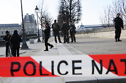 "Policemen patrol near the Louvre museum on February 3, 2017 in Paris, France, after a soldier patrolling at the museum shot and seriously injured a machete-wielding man who yelled ""Allahu Akbar"" as he attacked security forces, police said. One soldier was ""lightly injured"" and has been taken to hospital, while the knifeman is in a serious condition but is still alive, security forces said. Photo by Alain Apaydin/ABACAPRESS.COM"
