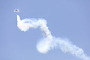 A Pitts aerobatics display aircraft flying towards the sun at the Australian International Airshow at Avalon airfield.