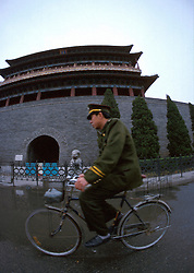 CHINA BEIJING APR99 - A Chinese policeman passes the Quianmen gate at Tiannanmen Square. This year on June 4 will mark the 10th anniversary of the Tiannanmen Square massacre in which an undisclosed number of student protesters were killed by police and armed forces.  jre/Photo by Jiri Rezac