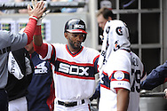 CHICAGO - APRIL 12:  Alexei Ramirez #10 of the Chicago White Sox celebrates with teammates against the Cleveland Indians on April 12, 2014 at U.S. Cellular Field in Chicago, Illinois.  The Indians defeated the White Sox 12-6 .  (Photo by Ron Vesely)   Subject:   Alexei Ramirez
