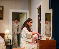 """Brick (David T. Bleiler) and Maggie (Jamie M. Clavet) during a dress rehearsal scene for """"Cat On a Hot Tin Roof"""" with the Winnipesaukee Playhouse on Tuesday evening.  (Karen Bobotas/for the Laconia Daily Sun)"""