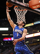 Dec. 09, 2012; Phoenix, AZ, USA; Orlando Magic guard J.J. Redick (7) lays up the ball during the game against the Phoenix Suns in the first half at US Airways Center.  Mandatory Credit: Jennifer Stewart-USA TODAY Sports.