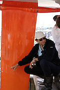 Dominique Wavre points out some strike damage on the keel as Temenos 2 is hauled out of the water in Wellington. Barcelona World Race. 2/1/2008