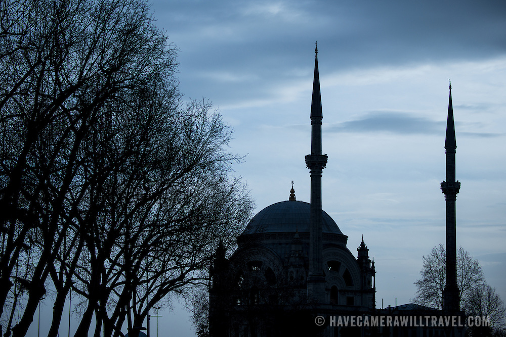 A sulhouette of Dolmabahce Mosque, next to Dolmabahce Palace, in Istanbul on the Bosphorus waterfront.
