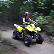 A female quad bike instructor riding through a quad bike course near Taupo with Taupo Quad Bikes. Taupo, North Island, New Zealand. 7th January 2011. Photo Tim Clayton.