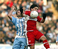 Photo: Chris Ratcliffe.<br />Coventry City v Middlesbrough. The FA Cup. 28/01/2006.<br />Don Hutchinson (L) of Coventry tussles with Fabio Rochemback of Boro.