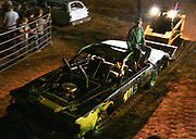 Arkansas Democrat-Gazette/BENJAMIN KRAIN --9/21/2013--<br /> A driver and his mechanic are pushed off the track by a bull dozer after becoming immobilized during the Des Arc Demolition Derby
