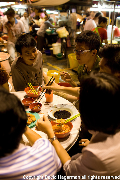 Locals outnumber tourists at the nighttime hawker stalls along Chulia Street.