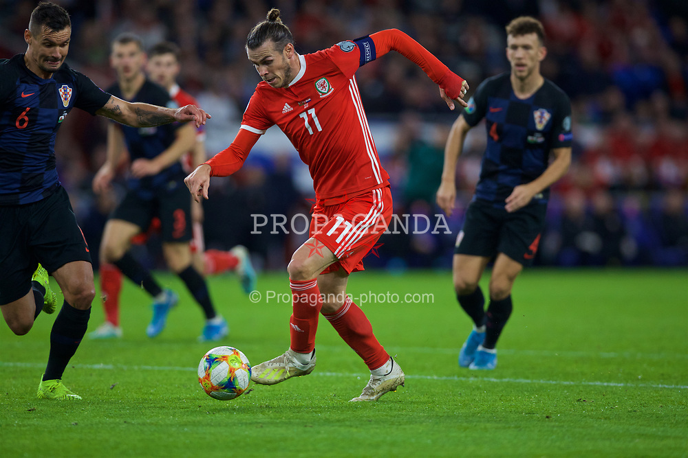 CARDIFF, WALES - Sunday, October 13, 2019: Wales' captain Gareth Bale on his way to scoring the equalising goal during the UEFA Euro 2020 Qualifying Group E match between Wales and Croatia at the Cardiff City Stadium. The game ended in a 1-1 draw. (Pic by Laura Malkin/Propaganda)