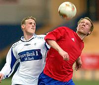 Vallhall 21.04.2003. Fotball herrer, 1. divisjon. Skeid Fotball mot FK Haugesund (3-1). Kjetil Rødahl i hodeduell med Christian Gulbrandsen.<br /> Foto: Geir Egil Skog, Digitalsport