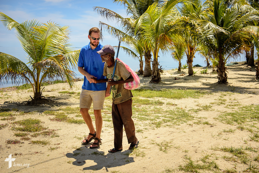 The Rev. Duane Meissner, career missionary to Belize, greets a man on the beach on Tuesday, Sept. 27, 2016, in Seine Bight, Belize. Meissner's objective is to plant the first Lutheran churches in the country. LCMS Communications/Erik M. Lunsford
