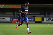 AFC Wimbledon defender Paul Kalambayi (30) warming up during the EFL Trophy group stage match between AFC Wimbledon and Stevenage at the Cherry Red Records Stadium, Kingston, England on 6 November 2018.