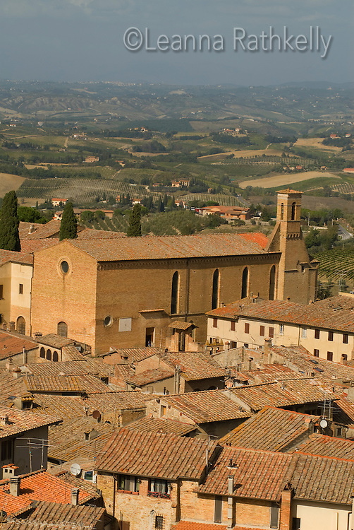 The view from the fortress at San Gigmignano in Tuscany, Italy overlooks the terracotta roofs of the residences below.