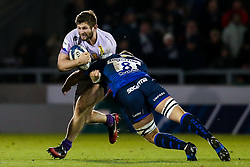 Alec Hepburn of Exeter Chiefs is tackled by Jono Ross of Sale Sharks - Mandatory by-line: Robbie Stephenson/JMP - 08/12/2019 - RUGBY - AJ Bell Stadium - Manchester, England - Sale Sharks v Exeter Chiefs - Heineken Champions Cup
