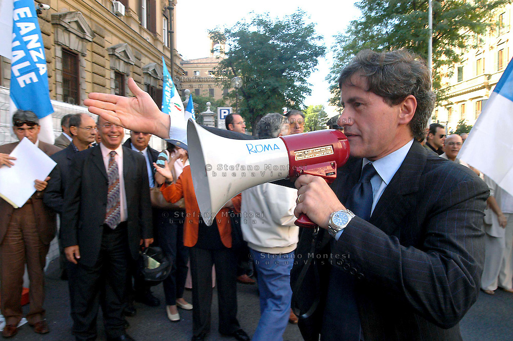 """Rome  September 27 2006.Demonstration of"""" House of Freedom"""" against the Government.Prodi and  the vice Minister of the Vincenzo Visco front of the Ministry of Economy .Gianni Alemanno  with the megaphone"""