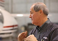 Barry Brown, Rockwell Collins Senior Captain, talks to a reporter as current and former Rockwell Collins employees say goodbye to their Sabreliner 50 test aircraft at the Eastern Iowa Airport on Wednesday, January 23, 2013.
