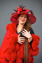 LIVERPOOL, ENGLAND - Friday, April 4, 2014: Natalie Broad from Stockport wearing a red mink cape during Ladies' Day on Day Two of the Aintree Grand National Festival at Aintree Racecourse. (Pic by David Rawcliffe/Propaganda)
