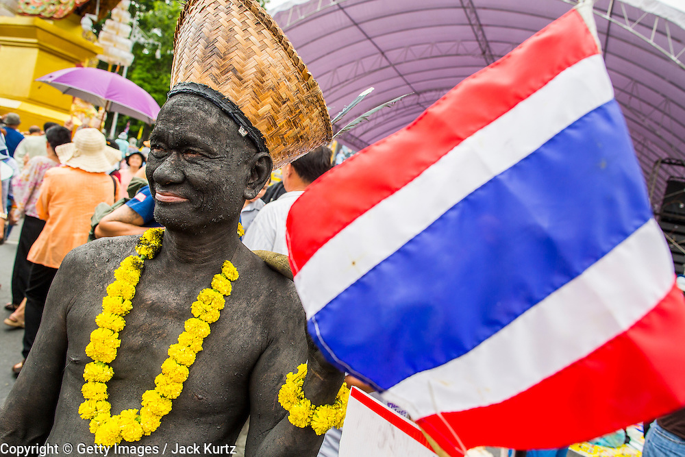 24 NOVEMBER 2012 - BANGKOK, THAILAND: An anti-government protester during a large anti government, pro-monarchy, protest  on November 24, 2012 in Bangkok, Thailand. The Siam Pitak group, which sponsored the protest, cited alleged government corruption and anti-monarchist elements within the ruling party as grounds for the protest. Police used tear gas and baton charges againt protesters.       PHOTO BY JACK KURTZ