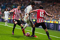 Real Madrid's Gareth Bale and Athletic de Bilbao's Javier Eraso and Inigo Lekue during La Liga Match at Santiago Bernabeu Stadium in Madrid. October 23, 2016. (ALTERPHOTOS/Borja B.Hojas)