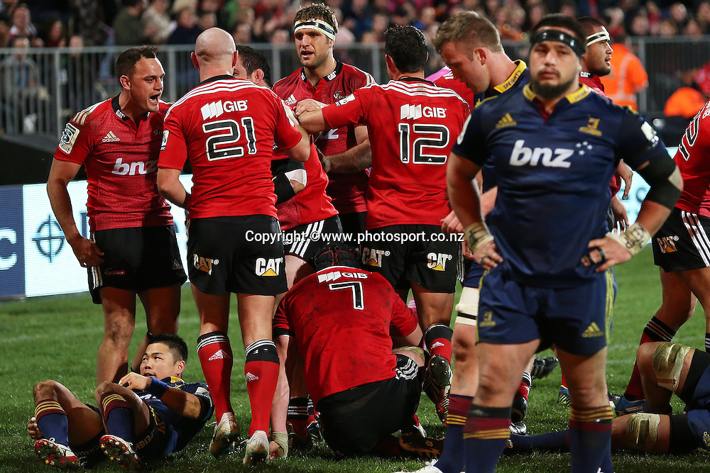 Crusaders players celebrate the bonus point try during the Investec Super Rugby game between Crusaders v Highlanders at AMI Stadium, Christchurch. 12 July 2014 Photo: Joseph Johnson/www.photosport.co.nz