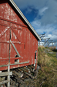 A, Norway.  Storage barn and fish drying racks.