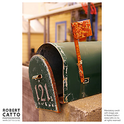 A single rusting letterbox in Scorching Bay, Wellington, New Zealand