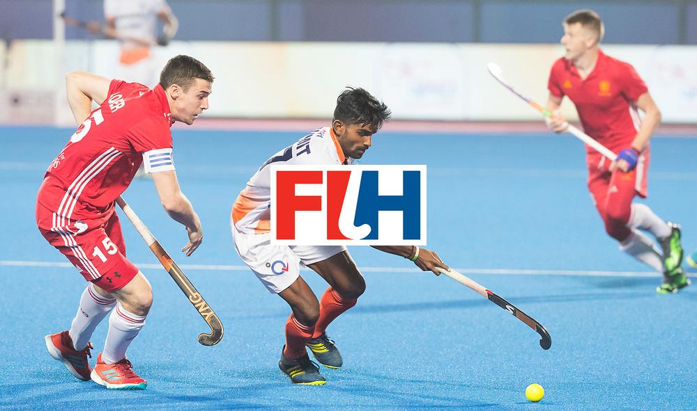BHUBANESWAR - The Odisha Men's Hockey World League Final . Match ID 06 . India v England. Sumit (Ind) with Phil Roper (Eng)      WORLDSPORTPICS COPYRIGHT  KOEN SUYK