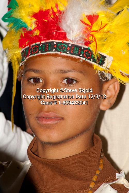 African American wearing native American headdress Minnesota history presentation. Horace Mann School St Paul Minnesota MN USA