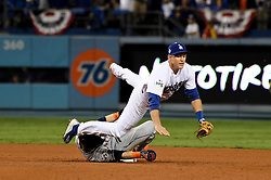 October 31, 2017 - Los Angeles, California, U.S. - Los Angeles Dodgers second baseman Chase Utley (26) forces out Houston Astros' Josh Reddick (22) at second base as Evan Gattis (not pictured) is safe on first base on a fielders choice in the 7th inning of game six of a World Series baseball game at Dodger Stadium on Tuesday, Oct. 31, 2017 in Los Angeles. (Photo by Keith Birmingham, Pasadena Star-News/SCNG) (Credit Image: © San Gabriel Valley Tribune via ZUMA Wire)