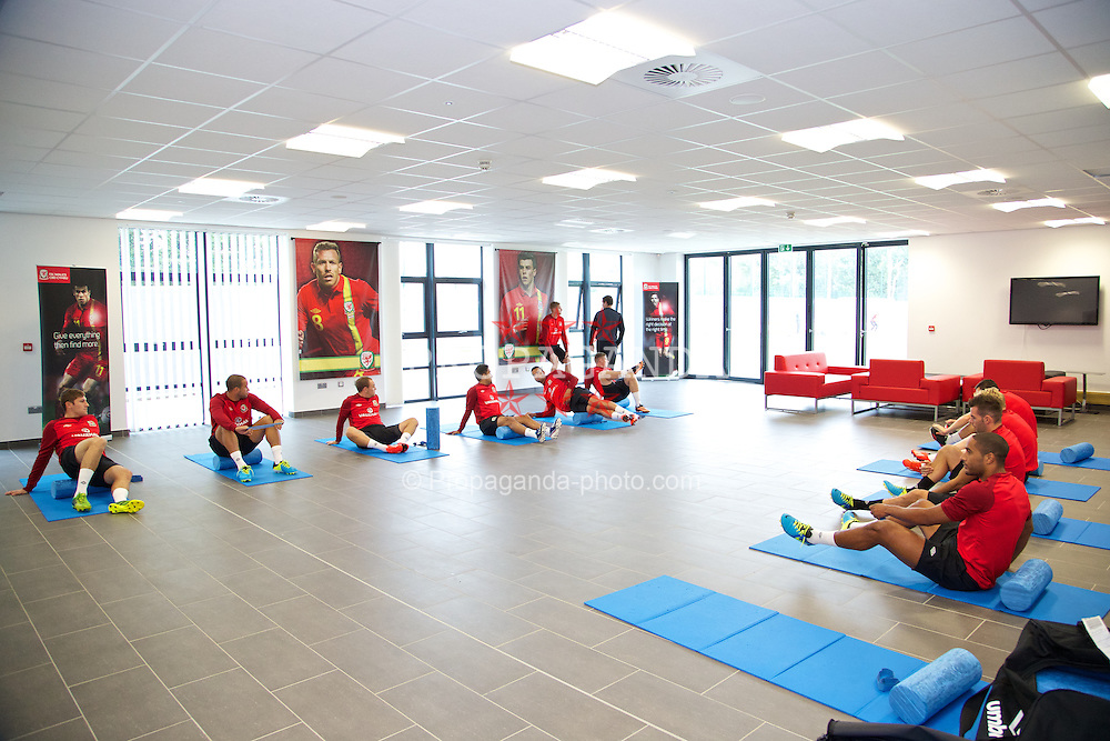 NEWPORT, WALES - Monday, August 12, 2013: Wales players perform 'pre-activation' inside during training at the FAW National Development Centre at Dragon Park ahead of the International friendly against the Republic of Ireland. (Pic by David Rawcliffe/Propaganda)