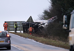 Storm Brendan, Monday 13th January 2020<br /> <br /> Strong winds from Storm Brendan hit Scotland this morning and blew over a lorry on the A704 near Breich Crossroads<br /> <br /> Pictured: The lorry on its side. Recovery teams then worked to get the lorry back on the road.<br /> <br /> Alex Todd | Edinburgh Elite media
