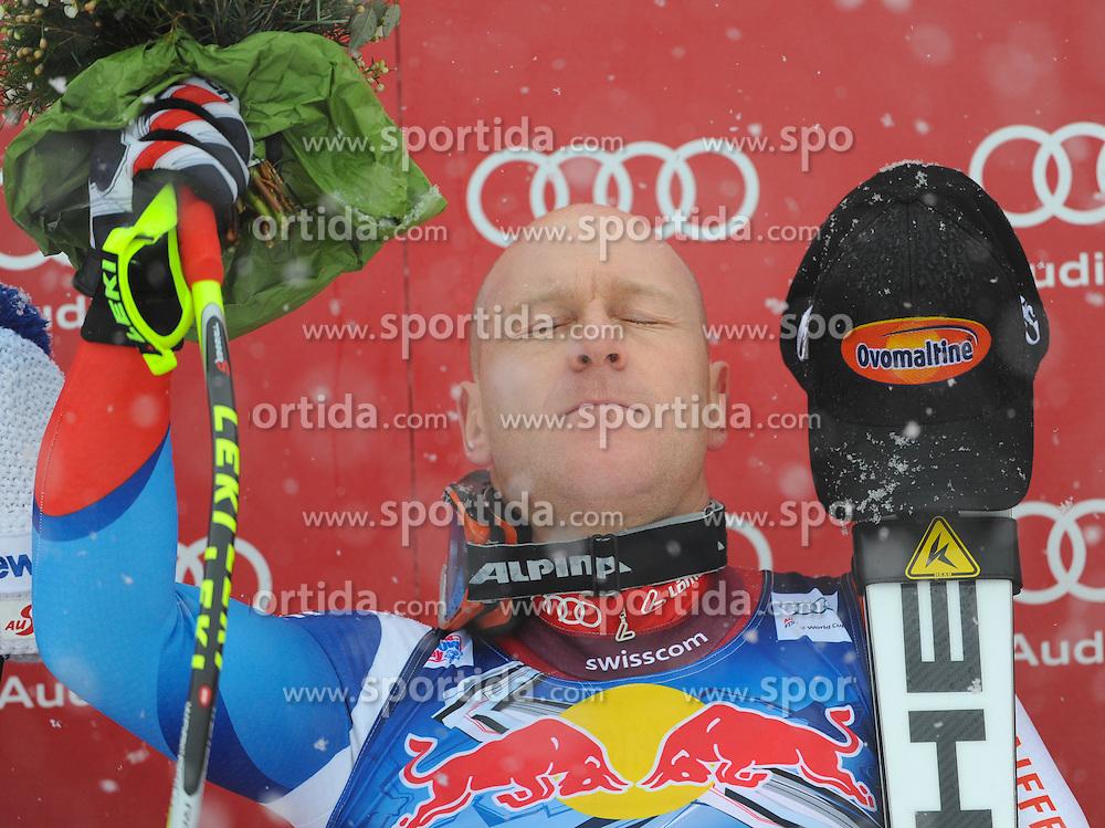 21.01.2012, Hahnenkamm, Kitzbuehel, AUT, FIS Weltcup Ski Alpin, 72. Hahnenkammrennen, Herren, Abfahrt, PODIUM, im Bild Didier Cuche (SUI, Platz 1) // first place Didier Cuche of Switzerland on podium during Downhill race of 72th Hahnenkammrace of FIS Ski Alpine World Cup at 'Streif' course in Kitzbuhel, Austria on 2012/01/21. EXPA Pictures © 2012, PhotoCredit: EXPA/ Erich Spiess