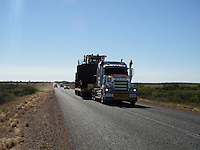 A truck transporting a Caterpillar to the mines in Newman, Western Australia