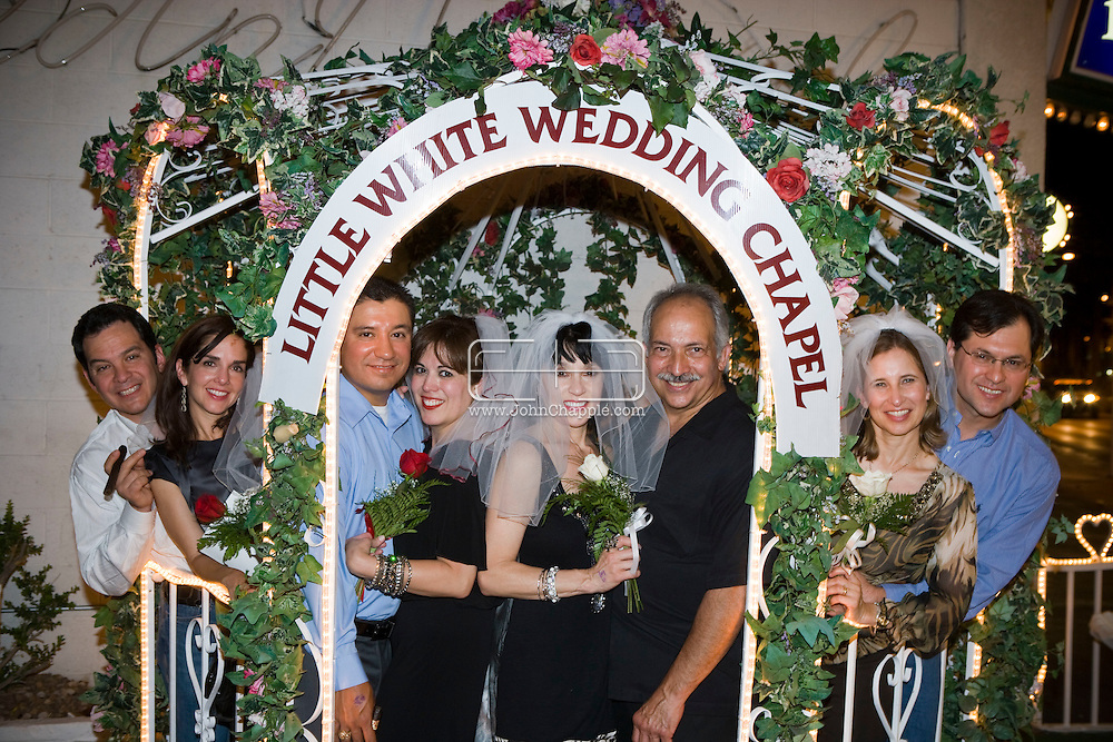 5th June 2010. Las Vegas, Nevada. Known around the world as one of the most Famous places to be married, The Little White Wedding Chapel in Las Vegas has wed stars from Britney Spears to Judy Garland. Pictured are four women in their forties from Texas with their doctor husbands, renewing their vows with Elvis. PHOTO © JOHN CHAPPLE / www.chapple.biz.john@chapple.biz  (001) 310 570 9100.