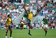 Twickenham, London - Sunday 23rd May 2010: Australia's Daniel Yakapo (jumping right) leaps with Ryno Benjamin of South Africa in the final of the the Emirates London Sevens rugby tournament at Twickenham Stadium, London, UK. Australia won by 19-14. (Pic by Andrew Tobin/Focus Images)