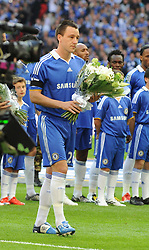 LONDON, ENGLAND - Saturday, April 18, 2009: Chelsea's captain John Terry presents flowers to the Hillsborough Family Support Group in memory of the 96 Liverpool supporters who died at an FA Cup Semi-Final 20 years ago in 1989, before the FA Cup Semi-Final match at Wembley. (Photo by Robin Parker/Pool/Propaganda)