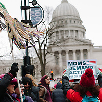 Madison, Wisconsin, USA. 24th March, 2018. Attendees of the Madison, Wisconsin March for Our Lives event listen to speakers at the states capitol building.