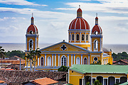 09 JANUARY 2007 - GRANADA, NICARAGUA:  The Cathedral in Granada, Nicaragua, as seen from the bell tower of the Corazon de Jesus church. Granada, founded in 1524, is one of the oldest cities in the Americas. Granada was relatively untouched by either the Nicaraguan revolution or the Contra War, so its colonial architecture survived relatively unscathed. It has emerged as the heart of Nicaragua's tourism revival.  Photo by Jack Kurtz