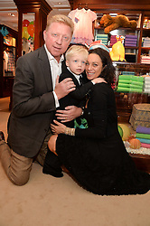 BORIS & LILLY BECKER and their son AMADEUS BECKER at the 4th birthday party for Amadeus Becker, son of Boris & Lilly Becker held at Ralph Lauren, 143 New Bond Street, London on 9th February 2014.