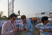 Race Director David McQuaid (L) and John Gloster (R) chat final logistics and sync their radios before the start of the UCI race - 2010 Tour of Mumbai Cyclothon - India