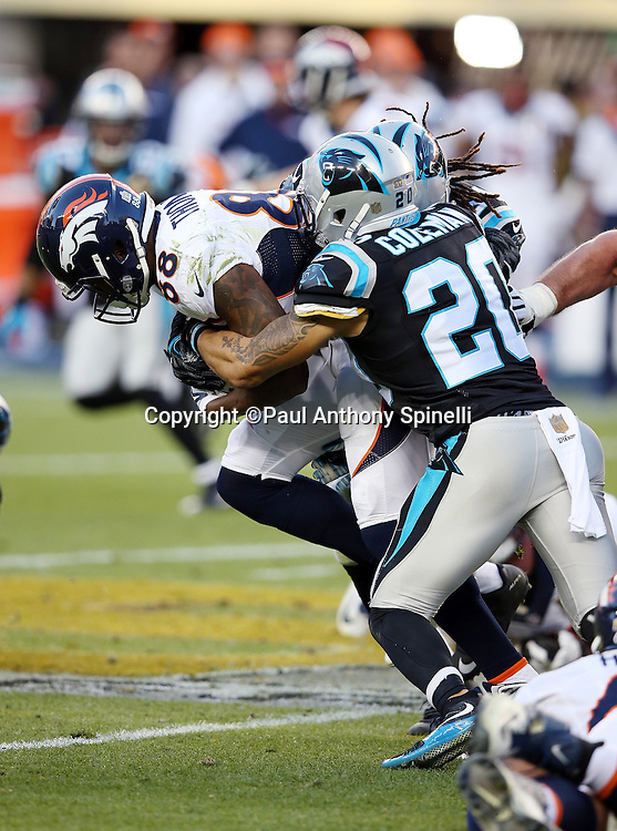 Denver Broncos wide receiver Demaryius Thomas (88) gets gang tackled by Carolina Panthers free safety Kurt Coleman (20) and Carolina Panthers cornerback Josh Norman (24) after catching a second quarter pass for a gain of 8 yards during the NFL Super Bowl 50 football game against the Carolina Panthers on Sunday, Feb. 7, 2016 in Santa Clara, Calif. The Broncos won the game 24-10. (©Paul Anthony Spinelli)