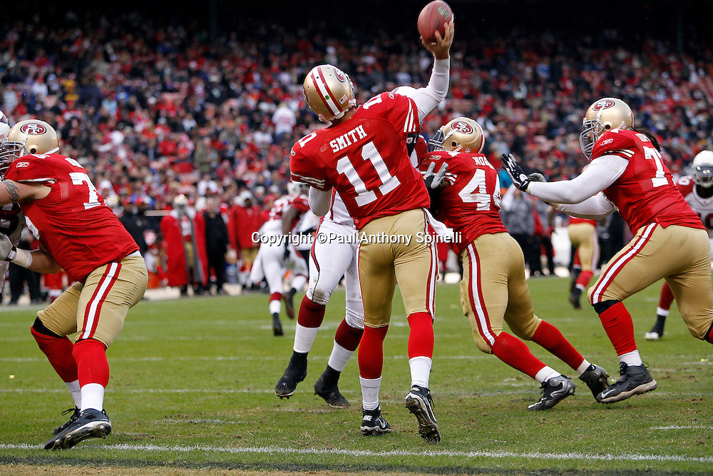 San Francisco 49ers quarterback Alex Smith (11) throws a deep pass with his own end zone at his back during the NFL week 17 football game against the Arizona Cardinals on Sunday, January 2, 2011 in San Francisco, California. The 49ers won the game 38-7. (©Paul Anthony Spinelli)