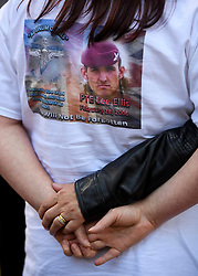 © Licensed to London News Pictures. 06/07/2016. London, UK. KARLA ELLIS, sister of Private Lee Ellis, 23, of Wythenshawe, who died during a home-made bomb explosion, being comforted as she is interviewed by media  outside the QE2 conference centre in London where the long-awaited Chilcot inquiry into the war in Iraq has been released. Photo credit: Ben Cawthra/LNP