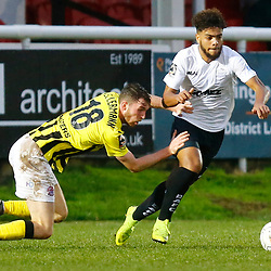 Dover's defender Josh Passley wrong foots AFC Fylde's midfielder Jim Kellermann during the National League match between Dover Athletic FC and AFC Flyde at Crabble Stadium, Kent on 08 December 2018. Photo by Matt Bristow.