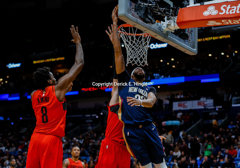 Jan 12, 2018; New Orleans, LA, USA; New Orleans Pelicans forward Anthony Davis (23) shoots over Portland Trail Blazers center Jusuf Nurkic (27) and forward Al-Farouq Aminu (8) during the second quarter at the Smoothie King Center. Mandatory Credit: Derick E. Hingle-USA TODAY Sports